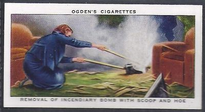 Removal of Incendiary Bomb with Scoop and Hoe - Ogden's Cigarette Card