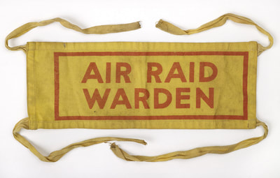 Early war Air Raid Warden armband fitted with cotton tapes (Birmingham Museum)