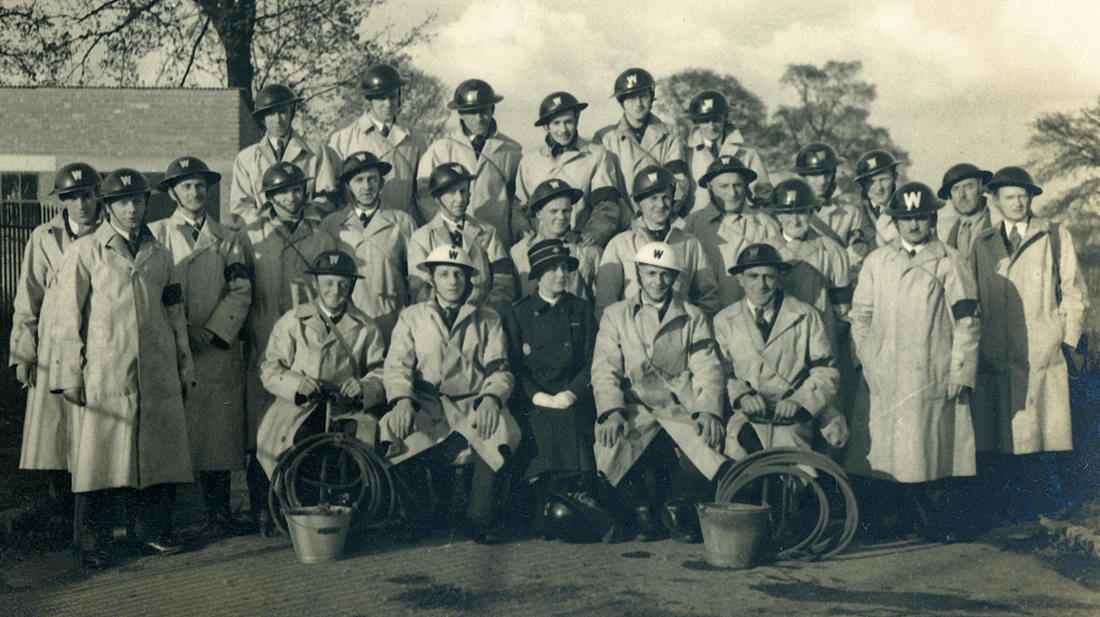 WW2 ARP Wardens with helmets, armbands and all in MacIntoshes.