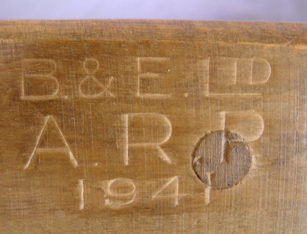 Maker's mark on WW2 gas rattle - B & E Ltd, ARP 1941