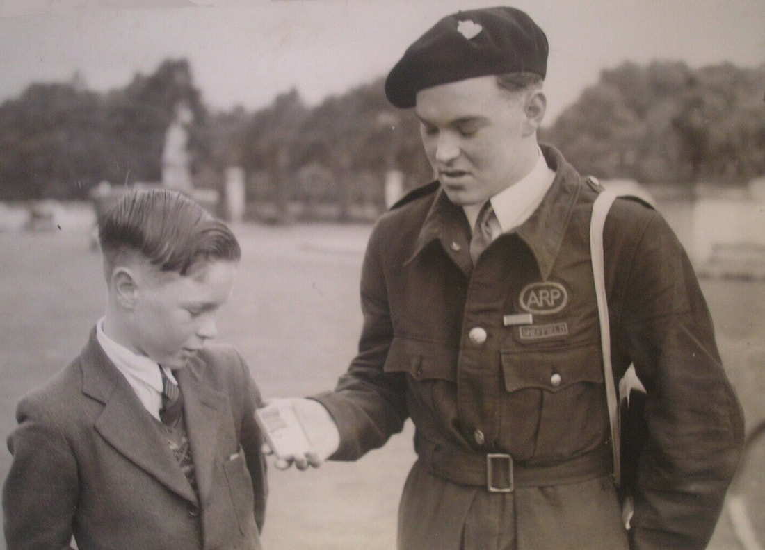 Dennis Bingham shows his brother Stanley his British Empire Medal (BEM)