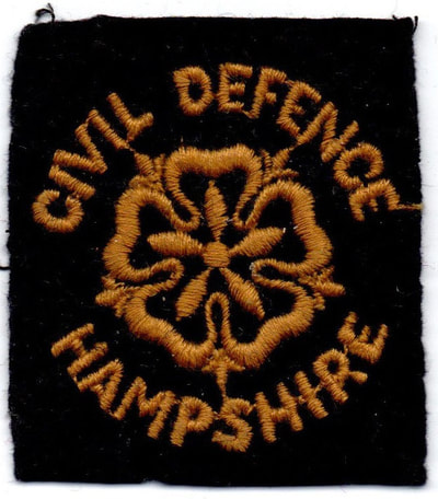 Badge sewn to epaulettes of Civil Defence services in Hampshire.
