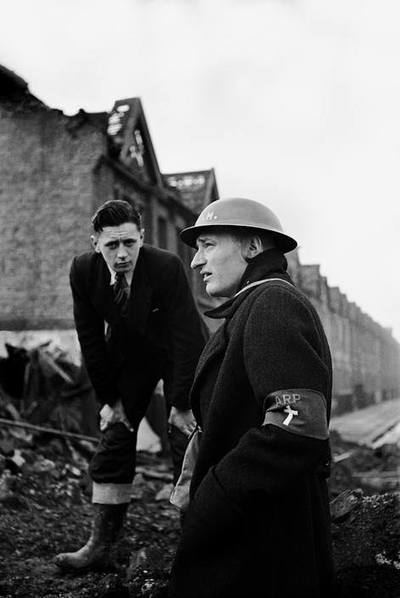 Rev. Paul Clifford of West Ham, London reviews his bomb damaged parish in 1940.