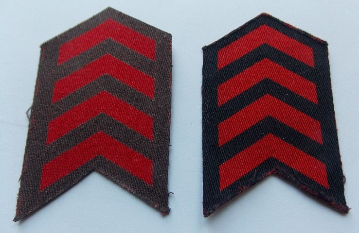 WW2 war service chevrons colour comparison - blue-grey (on the left) and the navy blue (on the right).