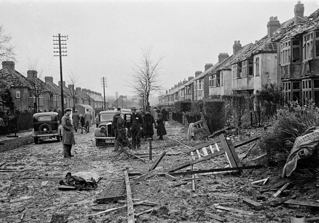 A street in Coventry following a Luftwaffe raid in 1940