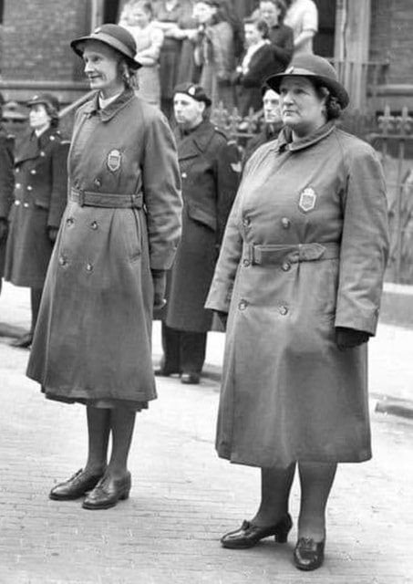 Civil Nursing Reserve nurses wearing the CNR greatcoat and badge
