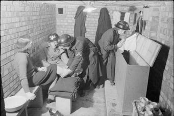 Shelter Marshal (in helmet marked SM) in an air raid shelter, London 1940