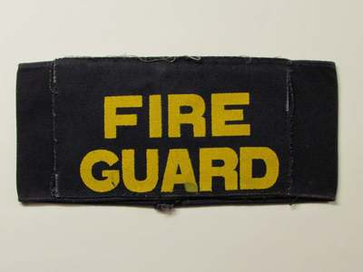WW2 Fire Guard armband - a patch has been sewn over a SFP armband.