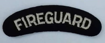 White Fire Guard shoulder title badge.