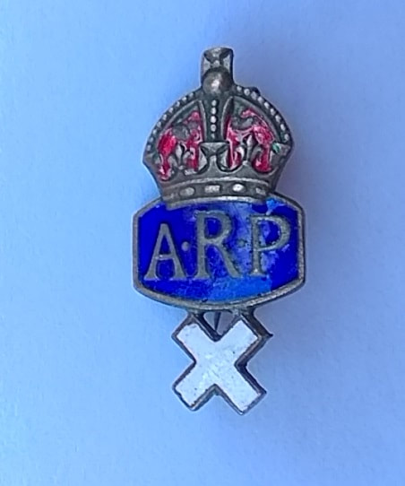 Curious WW2 ARP Lapel Badge With White Cross