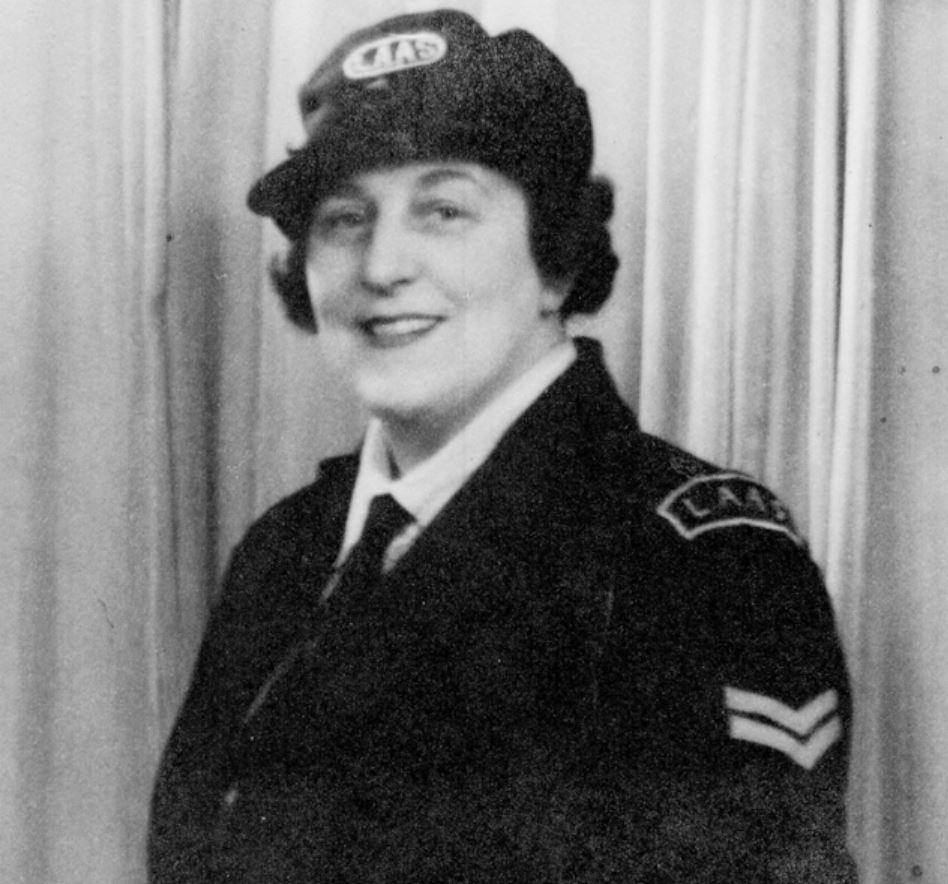 A WW2 London Auxiliary Ambulance Service (LAAS) driver displaying the cap and shoulder titles.