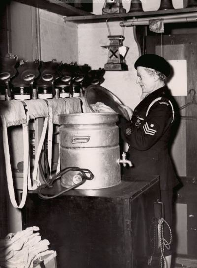 Lambeth Incident Officer Cleans The Tea Urn At Her ARP Post.