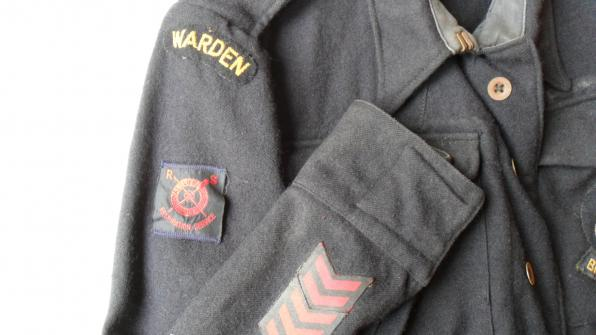 Odd position of Royal Life Saving Resuscitation Badge on WW2 Civil Defence battledress blouse.