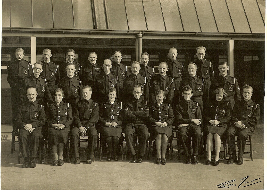 Group photo Of Civil Defence personnel.