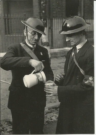Air raid wardens early in the second world war with unmarked helmets, ARP lapel badge and Civil Defence armband.