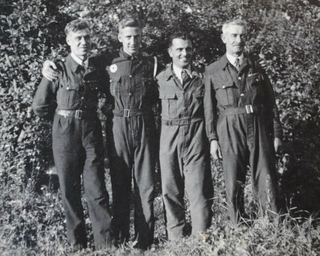 Original wartime photo showing four men wearing the bluette overalls