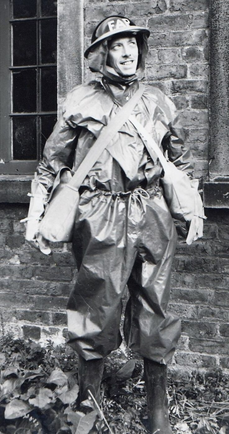 A member of a First Aid Party wearing the protective anti-gas oil skins