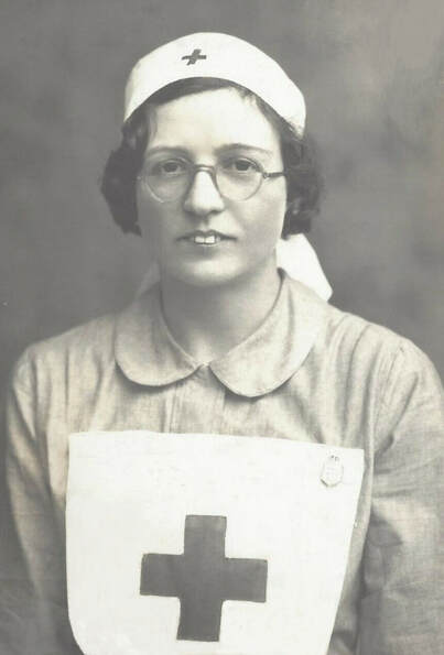 Nurse wearing the Civil Nursing Reserve badge on her apron